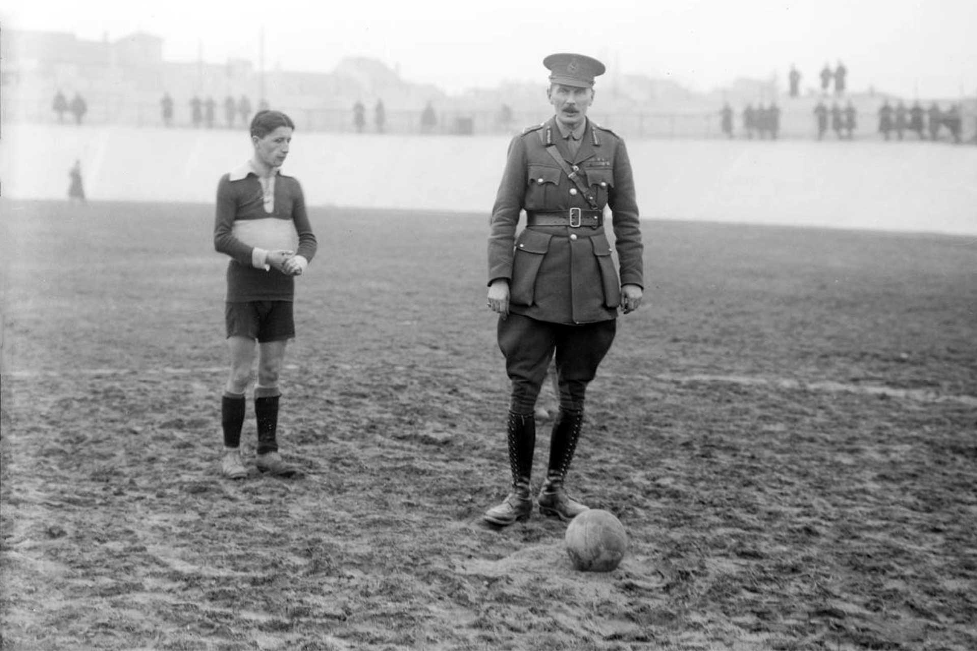 A British General about to kick off at a football match between British and Italian Armies teams during World War 1 (Photo: Ernest Brooks, Imperial War Museums / IWM Q 26566)